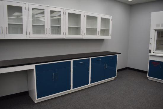 Blue laboratory cabinets will glass wall units.