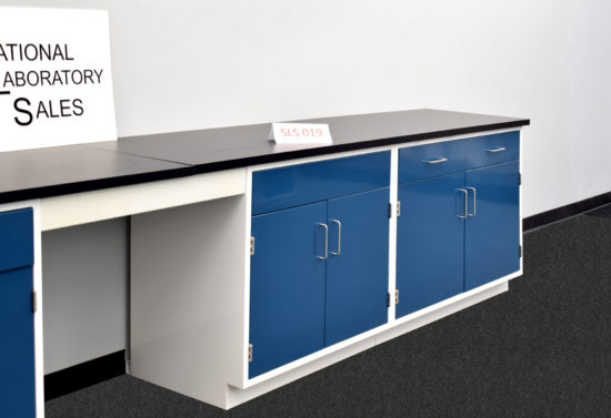 Blue laboratory cabinets with black epoxy work surface.