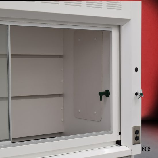 Close up view the working area of a 6 Foot Fisher American Fume Hood with two flammable cabinets