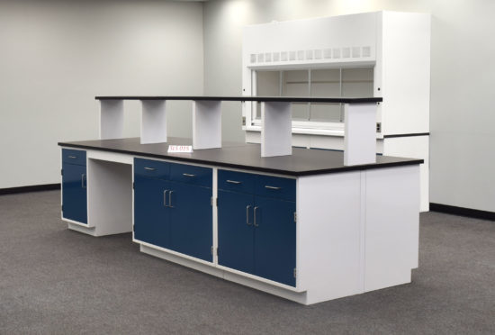 Laboratory island with desk area and center shelf.