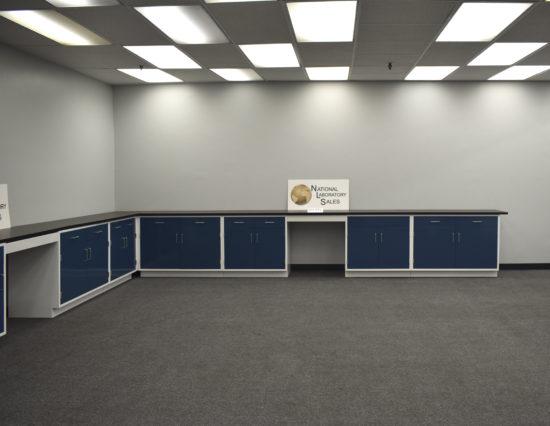 Blue laboratory cabinets with desk area.