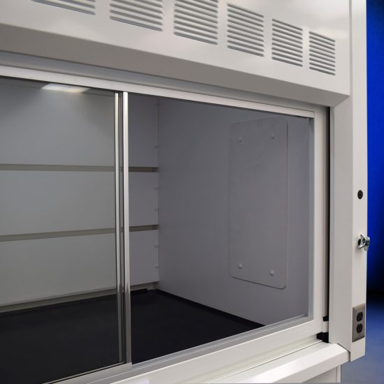 Close up view of Fisher American 6'x4' Fume Hood with two blue acid and two general storage cabinets.