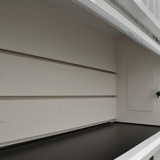 Close up view of an 8 foot Fisher American fume hood with acid and flammable cabinets